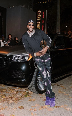 2 Chainz Wearing A Chrome Hearts Beanie And Long Sleeve T Shirt Louis Vuitton Bag And Sneakers