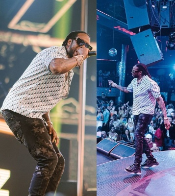 2 Chainz Wearing An Amiri Allover Monogram Shirt And Amiri X Chemist Jeans And Sneakers