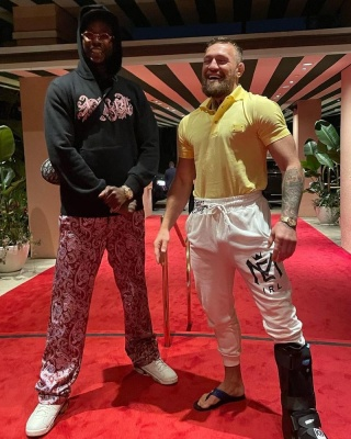 2 Chainz Wearing An Amiri Hoodie And Pants Alongside Connor Mcgregor In A Dolce And Gabbana Hoodie