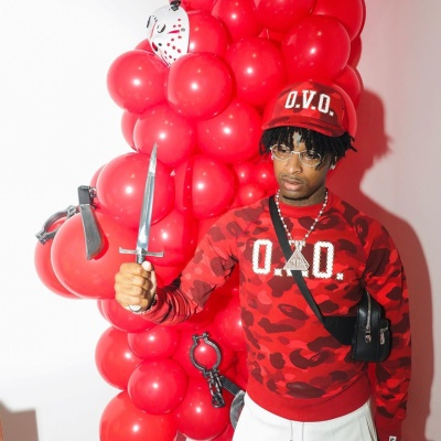 21 Savage Celebrates His Bday In A Bape X Ovo Hat And Sweatshirt And Louis Vuitton Bag
