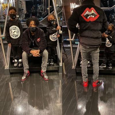 21 Savage Wearing A Chrome Hearts X Matty Boy Black Corduroy Jacket With Jordan 1 Black Red Metallic Sneakers