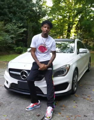 21 Savage Wearing A Loewe Tee With Palm Angels X Missoni Trackpants And Nike Air Force 1 Sneakes