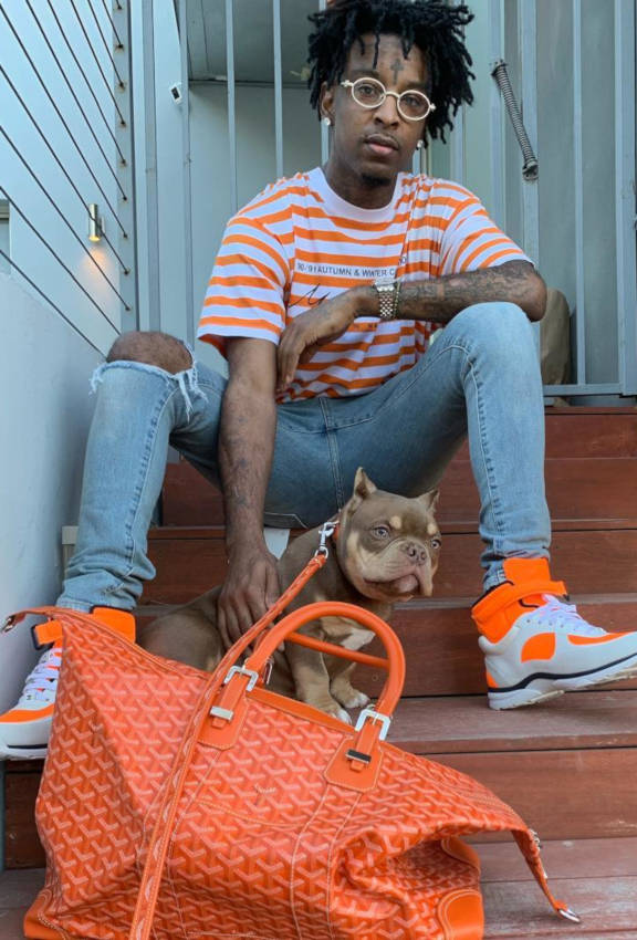 21 Savage Wearing A Orange And White Stiped Martine Rose Shirt With Orang Chanel Sneakers