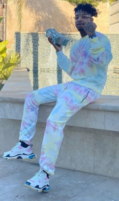 21 Savage Wearing Amiri Tie Dye Sweatshirt And Pants With Balenciaga Triple S Sneakers