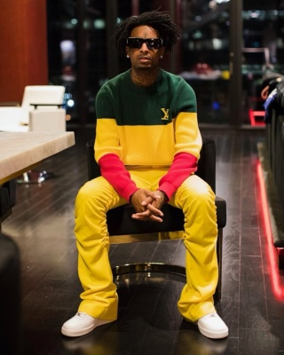 21 Savage Wearing Louis Vuitton X Nigo Sunglasses With A Louis Vuitton Rasta Sweater Yellow Pants And White Af1s