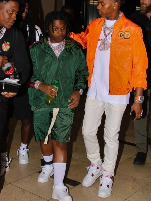 42 Dugg Wearing A Green Gucci Windbreaker And Gg Shorts With White Nike Air Force 1 Sneakers