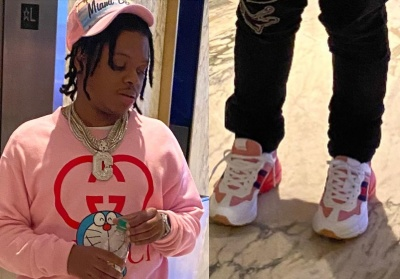42 Dugg Wearing A Gucci Sweatshirt And Sneakers With Amiri Varsity Jeans