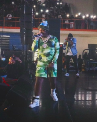 42 Dugg Wearing An Off White Green Camo Long Sleeve Tee And Shorts With A Supreme X Smurfs Beanie