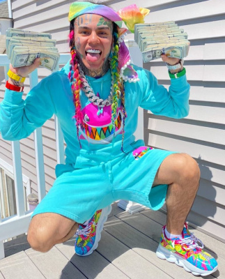 69 Shows Off His Cash In Gooba Merch And Versace Sneakers