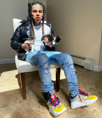 6ix9ine Holds Kittens In A Moncler Blue Puffer And Versace Sneakers