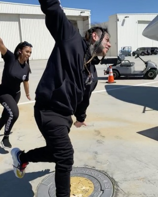 6ix9ine Runs Around His Jet In A Chrome Hearts Hoodie And Versace Joggers And Sneakers