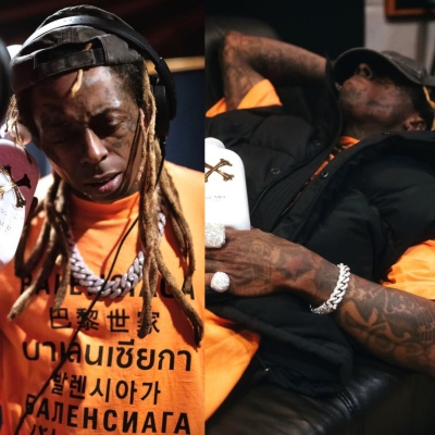 Lil Wayne Wearing A Balenciaga Orange Languages Tee And Black Puffer Vest In Bambu Rum Ad