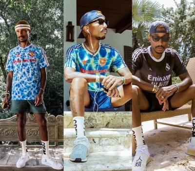 Pharrell Wearing A Man Utd X Human Race Arsenal X Human Race And Real Madric X Human Race Kit