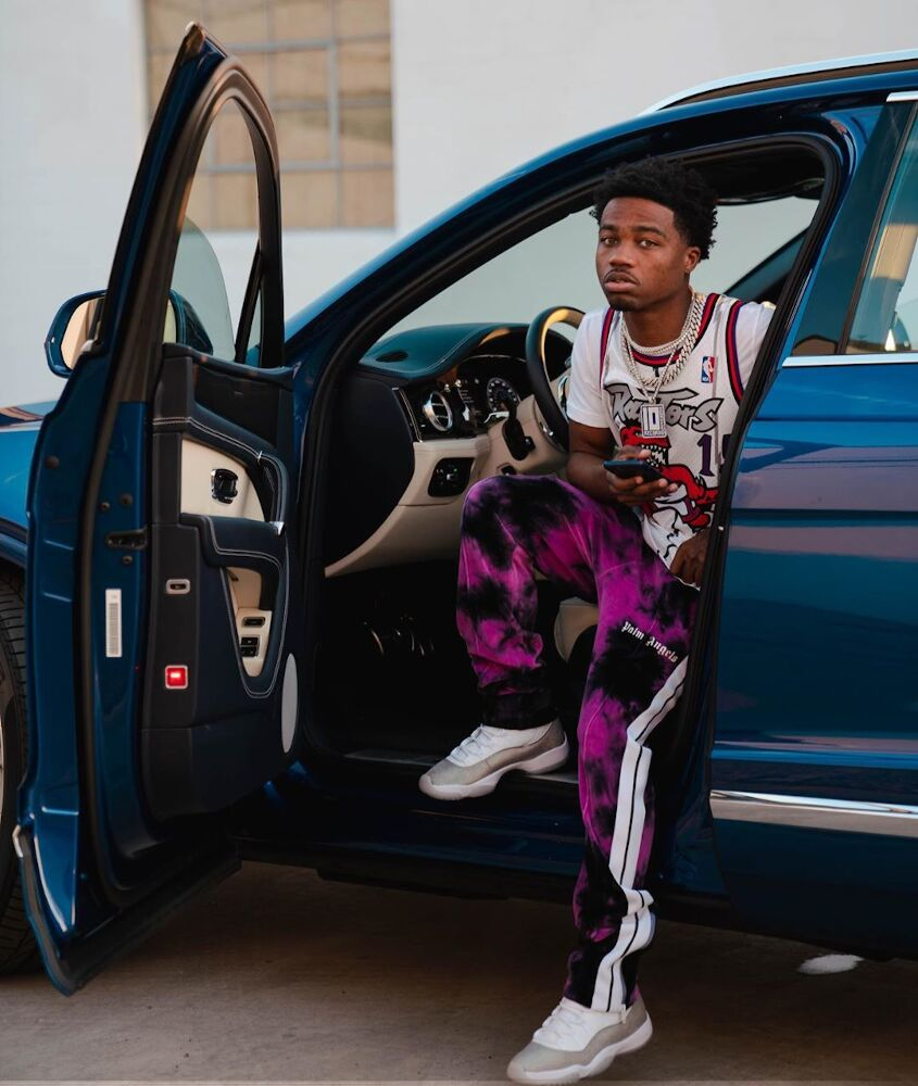 Roddy Ricch Wearing A Vince Carter Jersey With Palm Angels Pants Inside His Bentley Truck