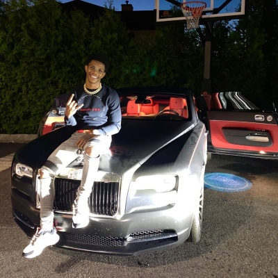 A Boogie Sits Atop His Rolly Royce In A Dior Sweatshit Amiri Jeans And Dior Sneakers