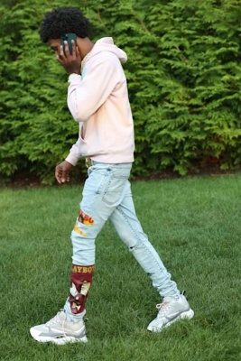 A Boogie Wearing A Dior X Alex Foxton Hoodie With Amiri X Playboy Jeans And Dior B22 Sneakers
