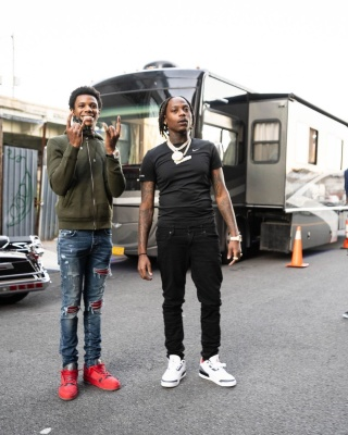 A Boogie Wearing A Green Lv Hoodie With Amiri Red Suede Patch Jeans And Louis Vuitton Red Trainer Sneakers
