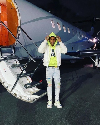 A Boogie Wearing A Louis Vuitton White Print Belt And Run Away Pulse Sneakers With Amiri Crystal Jeans And Off White Yellow Hoodie