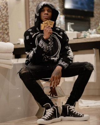 A Boogie Wearing An Amiri X Grateful Dead Hoodie With Amiri Black Camo Jeans And Dior Sneakers