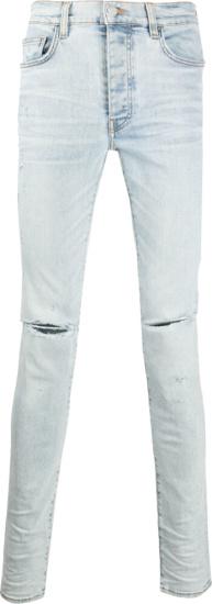 Amiri Light Wash Slash Jeans