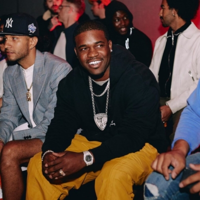 Asap Ferg Attends A Cold Wall Fashion Show In Acw Yellow Pants And Acw Black Hoodie