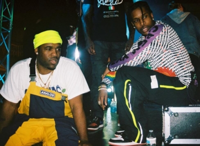 Asap Ferg Wearing Yellow And Blue Overalls And Asap Rocky Wearing A Cpfm X Alpinestars Jersey