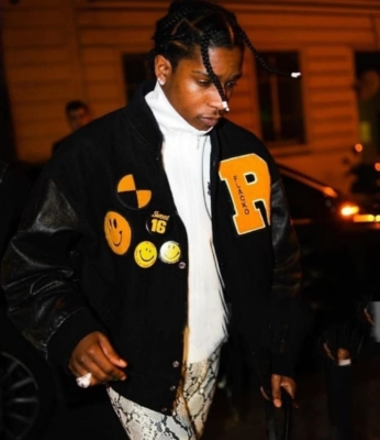 Asap Rocky At Paris Fashion Week Wearing A Black Varsity Jacket With Snake Print Pants And A White Track Jacket
