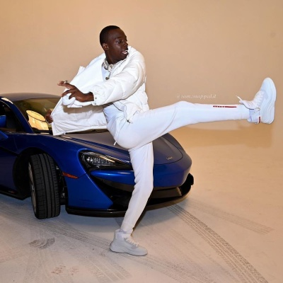 Bobby Shmurda Wearing A Prada White Puffer Jacket With Linea Rossa Trackpants And High Top Sneakers
