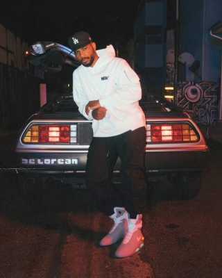 Bryston Tiller Wearing A New Era Dodgers Hat With A Nike X Sacai Hoodie Black Cargo Pants And Nike Mag Sneakers