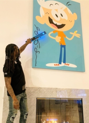 Chief Keef Hanging A Painting In A Rta Sanity Print Black T Shirt And Palm Angels Ripped Jeans