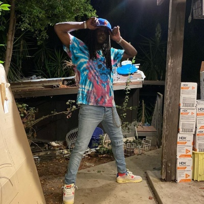 Chief Keef Wearing An Amiri Tie Dye Skull Tee Jordan Snakers And Ny Mets Hat