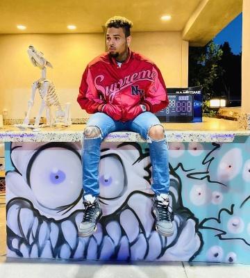 Chris Brown Wearing A Supreme Bomber Jacket With Jordan 5 Muslins