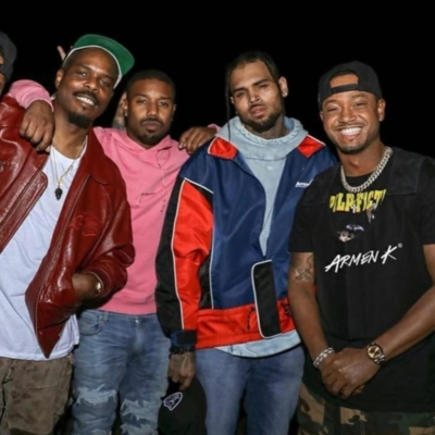 Chris Brown Wearing Ader Error Bleu And Red Jacket Jeans And A Blue Hoodie