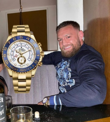 Conror Mcgregor Wearing A Rolex Yacht Master Ii With A Dolce Gabbana Navy Blue Crest Logo Sweater