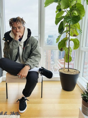 Cordae Wearing A Gucci Green Khaki Jacket And Puma Black Low Top Sneakers