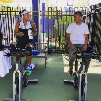Cordae Works Out With Girlfriend In Amiri Jeans And Puma Brown Sneakers