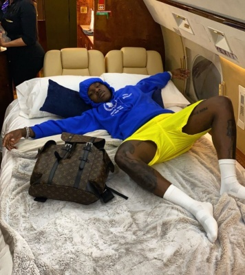 Dababy Crashes On Jet In A Balenciaga Wfp Hoodie Yellow Shorts And Louis Vuitton Brown Christopher Backpack