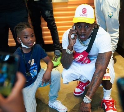 Dababy Wearing A Babpe X Coca Cola Trucker Hat Death Deams Shorts Burberry Belt Bag And Nike Dunk Sneakers