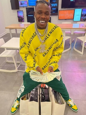 Dababy Wearing A Balenciaga Yellow Logo Sweater With Green Sweatpants And Nike Yellow And Green Dunk Sneakers
