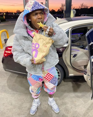 Dababy Wearing A Louis Vuitton Grey Monogram Puffer With Teddy Fresh Hoodie And Joggers And Jordan 11s