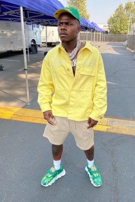 Dababy Wearing A Mitchell And Ness Seattle Super Sonics Hat With A Dior Yellow Denim Shirt And Versace Jungle Sneakers