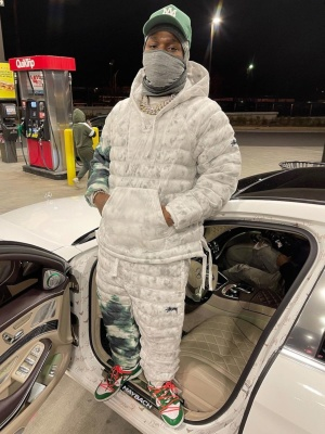 Dababy Wearing A Nike X Stussy Grey Green Tie Dye Puffer Jacket And Pants With Nike Dunk Off White Jeans