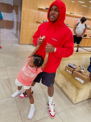 Dababy Wearing A Red Balenciaga Hoodie With Black Nike Shorts And Red And White Dunks