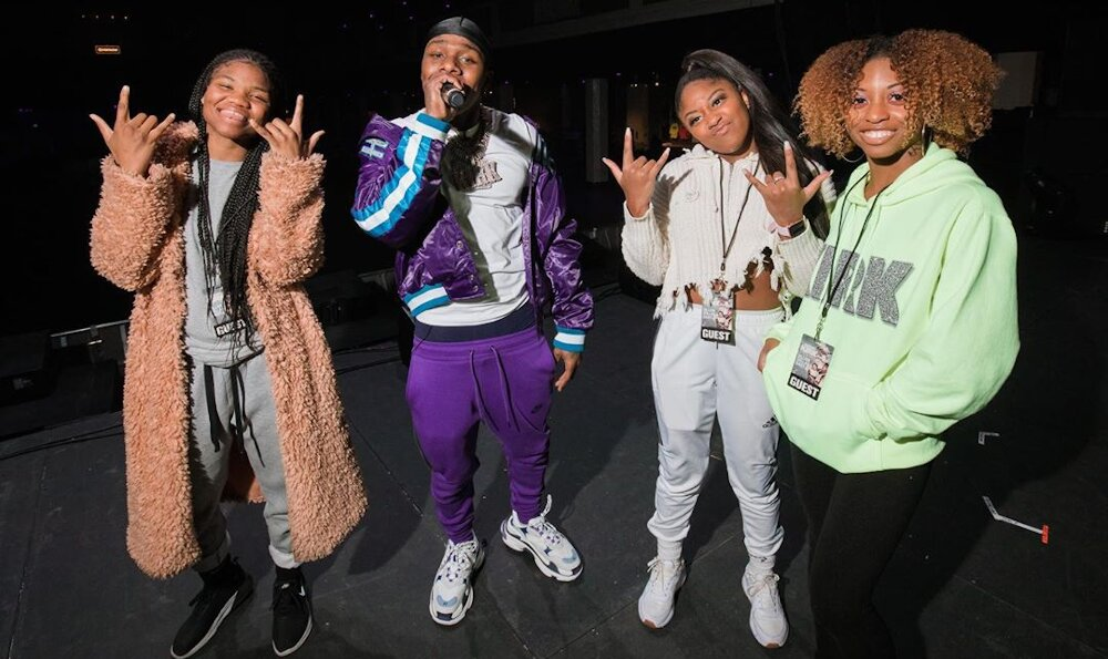 Dabay Performing In San Francisco In A Hornets Jacket Nike Joggers And Balenciaga Sneakers
