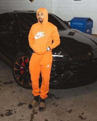 Ddg Wearing A Nike Orange Hoodie And Sweatpants With Yeezy Slides