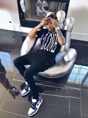 Ddg Wearing A Vlone X Palm Angels T Shirt With Black Jeans And Jordan 1 Purple Sneakers