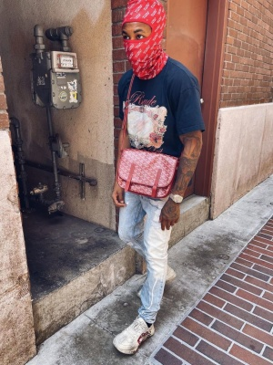 Ddg Weraring A Rhude Tee With A Goyard Messenger Bag Rolex Watchand Gucci Sneakers
