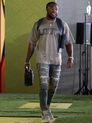 Derrick Henry Wearing A Louis Vuitton Grey Jersey With Amiri Snake Jeans And Jordan Sneakers