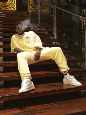 Diddy Wearing A Palm Angels Yellow Sweatshirt And Sweatpants With Maison Margiela Sneakers