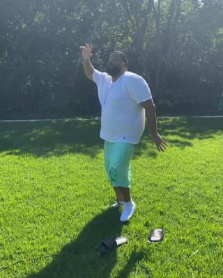 Dj Khaled Dances Ina Polo Ralph Lauren White Tee Green Jordan Swim Shorts And Black Slides